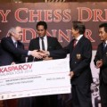 Garry-handing-over-a-cheque-to-Tan-Dri-Ramli-Ngah-Talib-to-help-start-Kasparov-Chess-Foundations-Asia-Pacifics-support-for-Chess-in-Education-copy-300x200