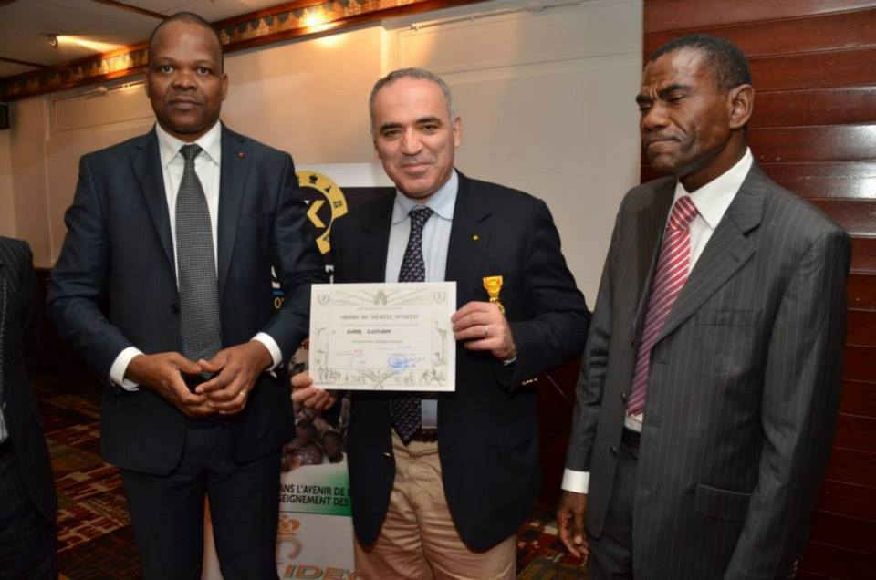 Receiving the Order of Merit for Sport from Mr. Alain Lobognon the Minister of Sports