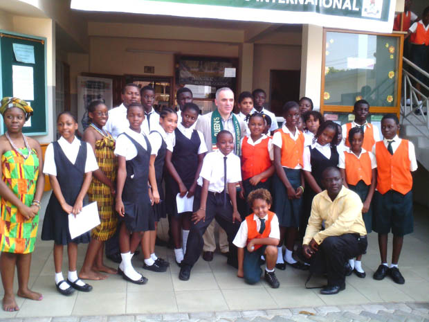 Photograph with students of Queen's International School
