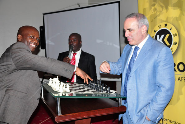 A chess enthusiast takes on Kasparov during an exhibition game in Kampala on Thursday. Photo BYGEOFFREY SSERUYANGE